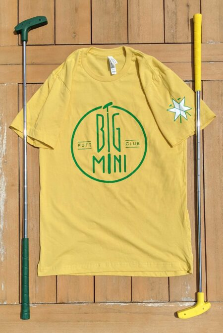 Yellow shirt with circle logo highlighting the star on the sleeve